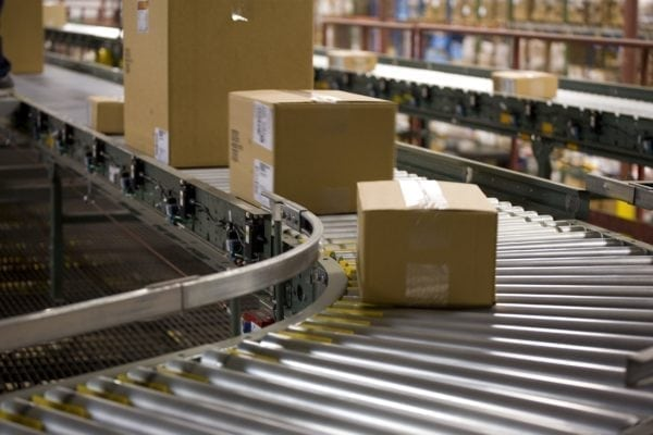 Picture of boxes being moved on a conveyor belt